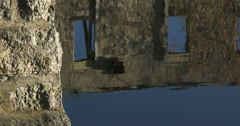 Ruins of old factory reflecting on Grand River in Elora, Canada Stock Footage