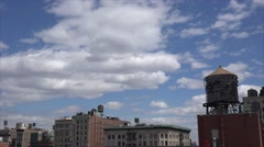 NYC cityscape with a wooden water towers at the roofs of the building. Stock Footage