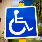 Blue handicapped sign with wheelchair Stock Photos