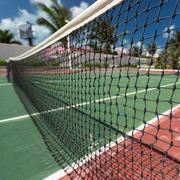 Stock Photo of Outdoor tennis net at court with nobody