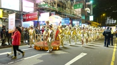 Shiny and zinger dance troop, festival procession on night street Stock Footage