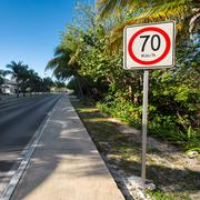 Seventy kilometers per hour speed limit on tropical  road - stock photo