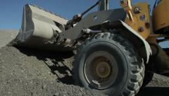 Excavator collect sand and gravel, roadworks, groundwork, close up. - stock footage