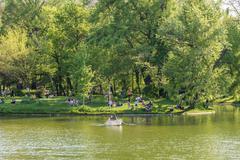 People Boat Ride On Carol Public Park Lake - stock photo