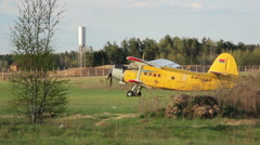 Small plane preparing for take-off in the field Stock Footage