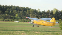 Small plane takes off on the field near the forest Stock Footage