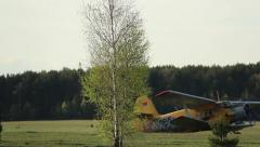 Small passenger plane rides across the field to the runway Stock Footage
