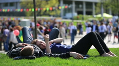 Couple in love on the grass in a city Park. Stock Footage