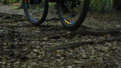 Mountain bike quickly goes through the woods Stock Footage