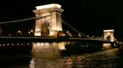 Chain bridge at night with cars, Budapest - stock footage