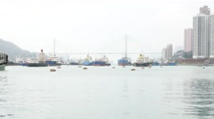 Diverse of ships on mooring area against Ting Kau Bridge, Hong Kong Stock Footage