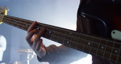 4K Close up on hands of the guitarist performing in a rock band at live event - stock footage