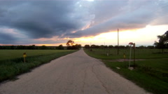 Rural Country Road Leads to Sunset Thunderstorm Approaching Arkistovideo