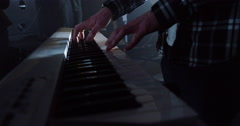 4K Focus on keyboard player in a rock band, performing at live music event Stock Footage
