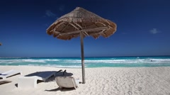 Caribbean beach with grass umbrellas and wooden beds Stock Footage