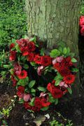Heart shaped sympathy flowers - stock photo