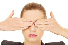 Businesswoman covering eyes with hands. - stock photo