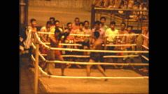 Vintage 16mm film, Thai kickboxing, indoor low light, shadowy 1973 Stock Footage