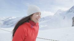 Woman in snow mountain in Swiss alps Switzerland -  hiking in snowy landscape Stock Footage