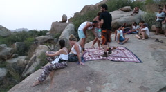 People sitting on the large stones in Hampi. Stock Footage