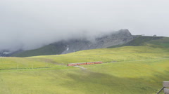 Train traveling in Swiss Alps in Switzerland Europe in summer Stock Footage