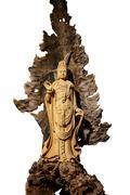 Guan Yin wood carving Stock Photos
