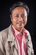 portrait close up smiling happiness face of 59s years old asian man with stud - stock photo