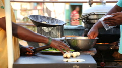 Indian people preparing food on the street in Hampi. Stock Footage