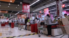 People line up a queue and checkout in a supermarket, Chengdu, Sichuan, China Stock Footage