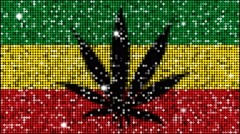 Marijuana leaf on Jamaica flag - seamless looping with reflectors and sparkles - stock footage