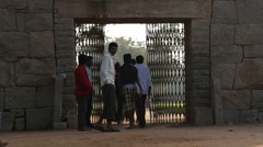 People passing through the big stoned gate. Stock Footage