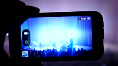 Spectator record a concert show with the phone camera Stock Footage