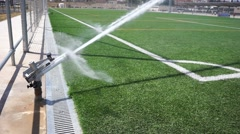 An Industrial Sprinkler Watering a Sports Field Stock Footage