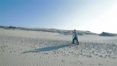 371 Young couple walking in natural sand dunes hill landscape Stock Footage