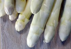 luscious white asparagus tips for sale from greengrocers in spring - stock photo