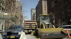 Construction vehicle; ho truck; digger tractor on 5th Avenue in 4K Manhattan NYC Stock Footage