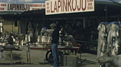 Inari, Lapland 1979: tourist in a souvenir shop - stock footage