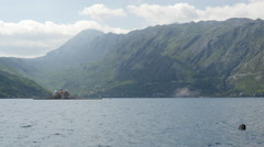 Pan from The artificial island Gospa od Škrpjela to  Perast in Montenegro Stock Footage