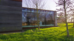 4K Exterior view of contemporary office building in natural setting. No people. Stock Footage