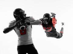american football player quarterback sacked silhouette - stock photo