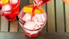 Top of view of pouring red spritz aperitif aperol cocktail with orange slices Stock Footage