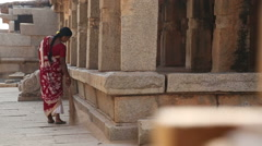 Woman brooming in front of the temple in Hampi. Stock Footage