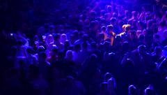 Crowd of young people dancing on party - stock footage