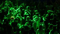 Crowd of young people dancing on party Stock Footage