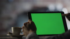 Using Tablet PC with Green Screen in Landscape Mode In Cafe - stock footage