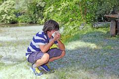 Boy with pollen allergy with handkerchief in hand Stock Photos