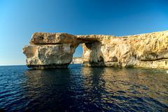 Azure Window, famous stone arch on Gozo island with reflection, Malta Stock Photos
