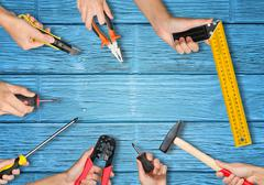 Set of peoples hands holding tools Stock Photos