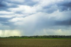 Rural landscape with rain clouds Stock Photos