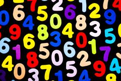 Brightly coloured numbers on black background - stock illustration